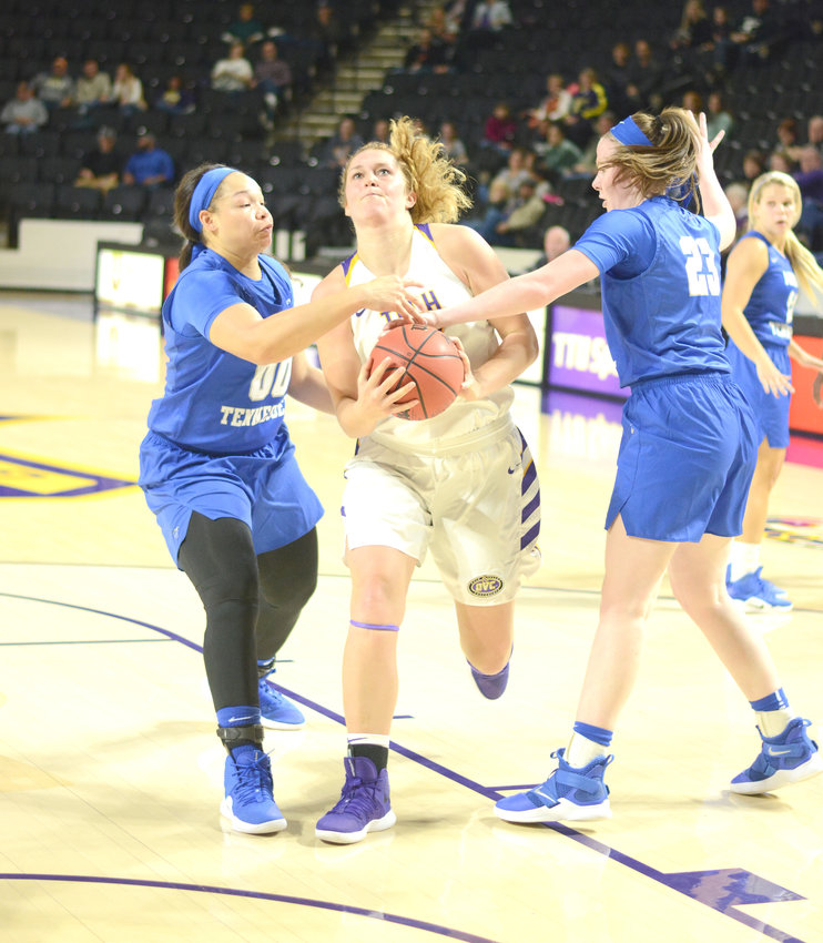 Tennessee Tech's Lacy Cantrell, center, splits two defenders during a recent game against MTSU at the Hooper Eblen Center.