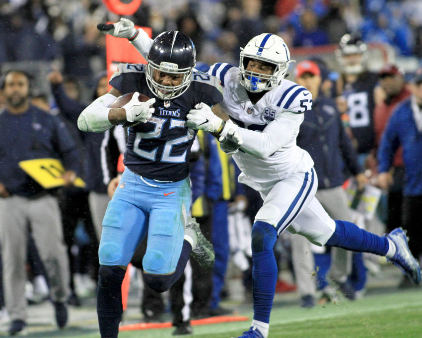 Tennessee Titans running back Derrick Henry (22) with a big run and a stiff-arm to Indianapolis Colts outside linebacker Darius Leonard (53) during the second half of the NFL game at Nissan Stadium in Nashville, Tenn., on Dec. 30, 2018. The Colts win 33-17. (Photo by Matthew Maxey)