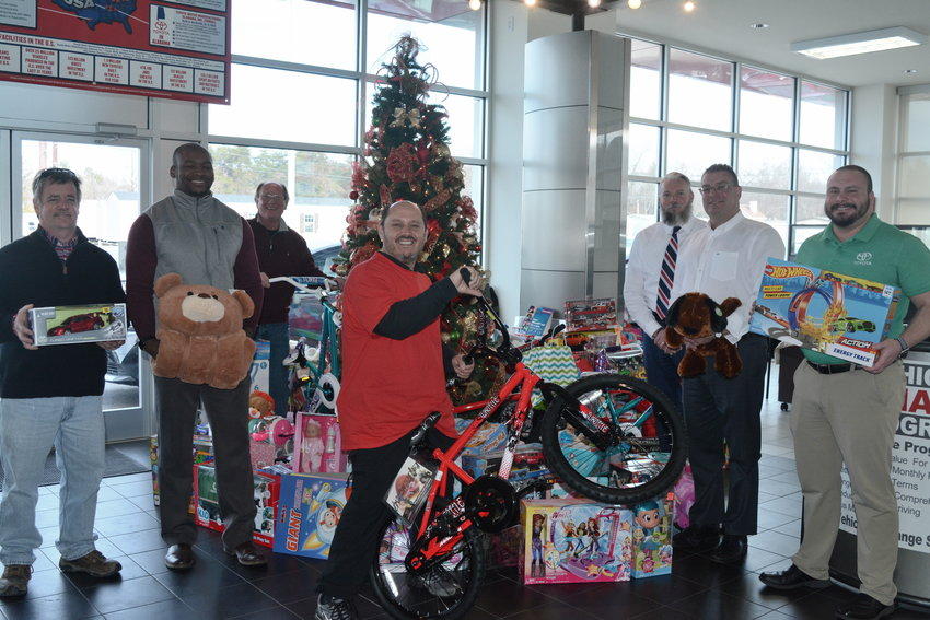 Organizers and volunteers with Toys for Tots make pit stops to toy collection sites. The second stop is Cumberland Toyota. From left are Bob Sotis, Toys for Tots; T.C. Coleman, Cumberland Toyota; Freddy Duncan, Toys for Tots; Jimmie Hodge, Toys for Tots; Brandon Davidson, Cumberland Toyota; Brandon Hall, vice president of Cumberland Toyota; and Jeremy Whitson, Cumberland Toyota. Tickets for Toys For Tots will be handed out at Life Church from 4 to 7 p.m., Tuesday, Dec. 11, and 2 p.m. until tickets are gone, Thursday, Dec. 13.