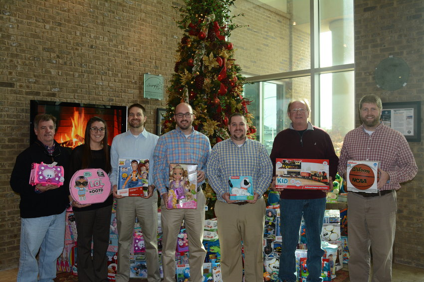 Organizers and volunteers with Toys for Tots make pit stops to toy collection sites. The first stop was J&S Construction. From left are Bob Sotis, Toys for Tots; Jensen Rohr, J&S Construction; Matt Davenport, J&S Construction; Keenan Muncie, J&S Construction; Andrew Scarborough, J&S Construction; Freddy Duncan, Toys for Tots; and Ryan Morris, J&S Construction. Tickets for Toys For Tots will be handed out at Life Church from 4 to 7 p.m., Tuesday, Dec. 11, and 2 p.m. until tickets are gone, Thursday, Dec. 13.