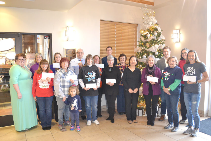 The Cookeville Junior Woman's Club presented checks to several non-profit agencies. From left, are Sarah Starkey, CJWC; Bea O'Donnell, CJWC; Angela Hayes, Kids Putnam; Karen Knight, Happy Haven Children's Home; Bobbie Abell, Manna's Hana Riding Center; Steve Chapman, Master Singers; Tana Taylor, Putnam County Humane Society; Nancy Knowlton, Cookeville Pregnancy Clinic; John Bell, CRMC Charitable Foundation; Debbie Handlson, Helping Hands of Putnam County; Kathy Smith, Cookeville Housing Services; Mae Fowler, Mended Hearts; Paula King, Heart of the Cumberland; Seth Krun, RAM Clinic; Nancy Flatt, Heart of the Cumberland; Diane Glasgow, CJWC; and Ashley Swann, Food to the Rescue.