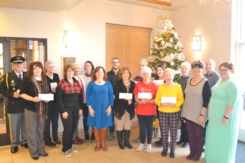 At the Santa's Workshop check presentation are, from left, Jim McAfee, Veterans Honor Guard; Tracy Plant, Upper Cumberland Children's Advocacy Center; Linda Cohoon, Pilot Club of Cookeville; Angie Crawford, CJWC; Susan Moores, Pilot Club of Cookeville; Cody Richards, CJWC; Deb Allen, CJWC; Brandon Stephenson, Mustard Seed Ranch; Lisa Russell, Mended Little Hearts, Melissa Parks, Habitat for Humanity; Marsha Godsey, Mended Little Hearts; Susan Simpson, Putnam County Health Department; Patricia Phillips, Putnam County Friends of the Library; Connie Albrecht, Putnam County Friends of the Library; Dylcia Cowan, CJWC; Greg LaPlant, Putnam County Friends of the Library; and Sarah Starkey, CJWC.