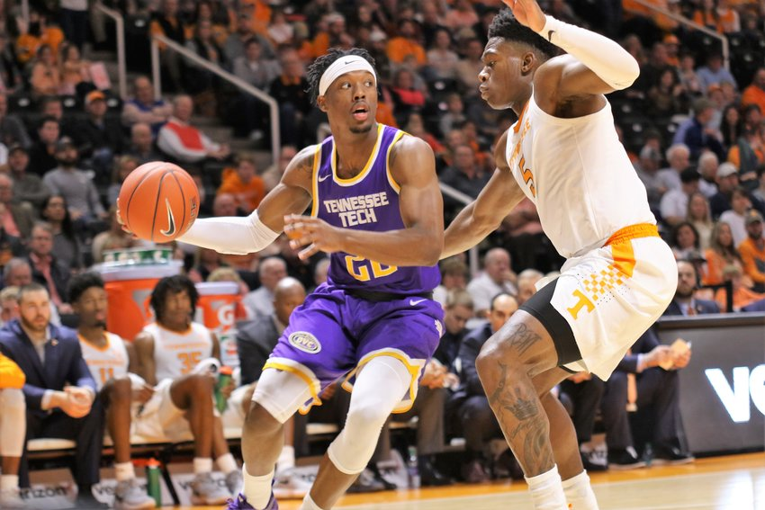 Tennessee Tech's Courtney Alexander, left, drives against a Tennessee defender during a game Saturday in Knoxville.