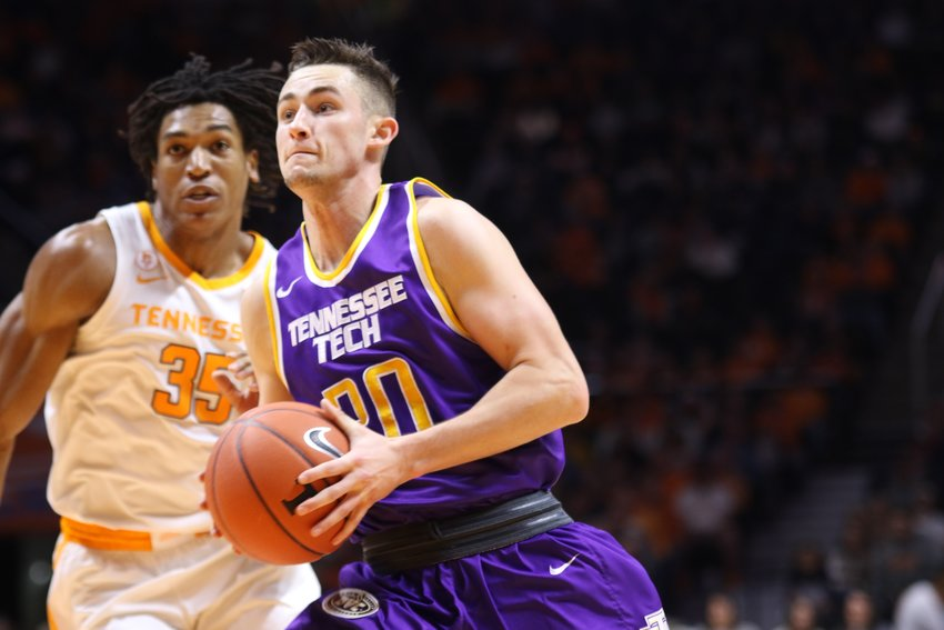 Tennessee Tech's Hunter Vick, right, drives against a Tennessee defender during a game Saturday in Knoxville.