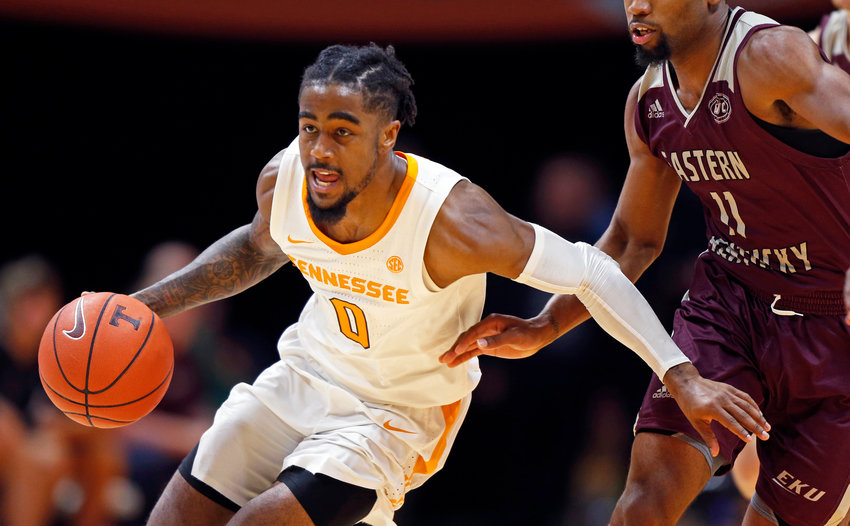 FILE - In this Nov. 28, 2018, file photo, Tennessee guard Jordan Bone (0) drives past Eastern Kentucky guard Jomaru Brown (11) during an NCAA college basketball game in Knoxville, Tenn. For a guy whose game is built on speed, Bone has required plenty of patience in his slow but steady emergence as one of the Southeastern Conference's top point guards. (AP Photo/Wade Payne, File)