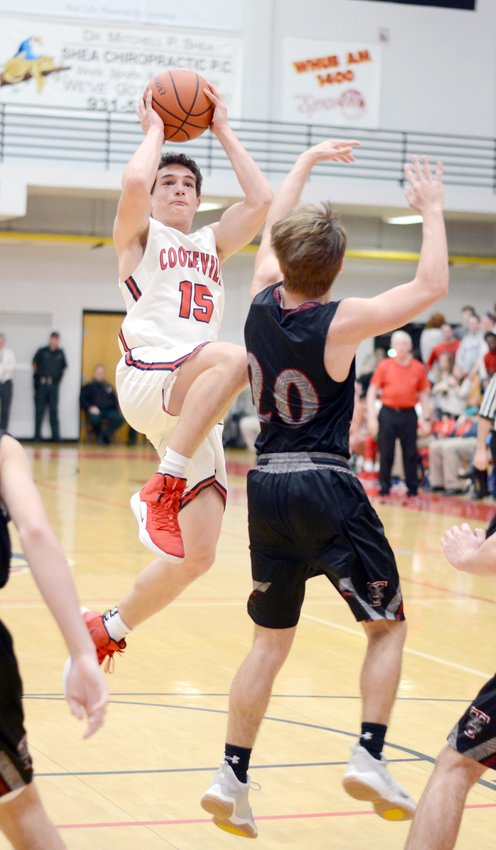 Cookeville's Stockton Owen, left, shoots over a Tullahoma defender during the Cavs' 68-47 win over the Wildcats Thursday at CHS.