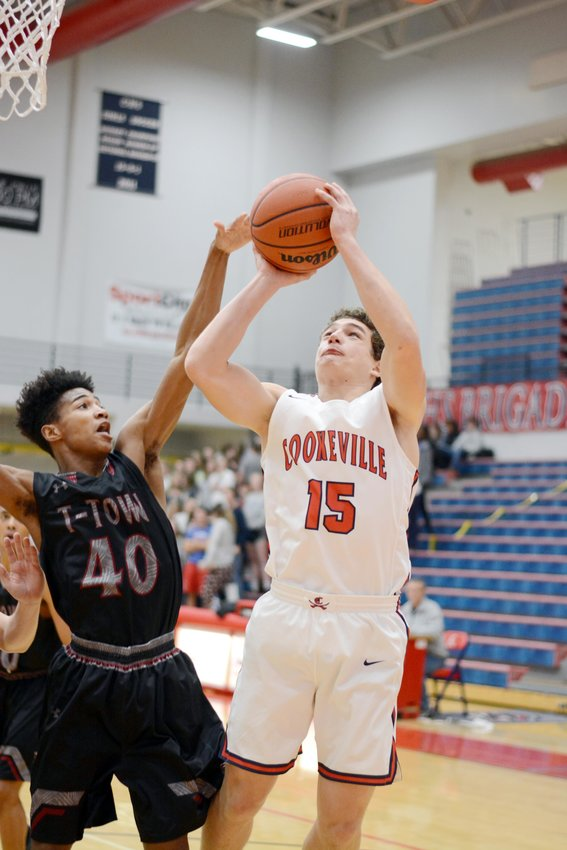 Cookeville's Stockton Owen, right, shoots over a Tullahoma defender during the Cavs' 68-47 win over the Wildcats Thursday at CHS.