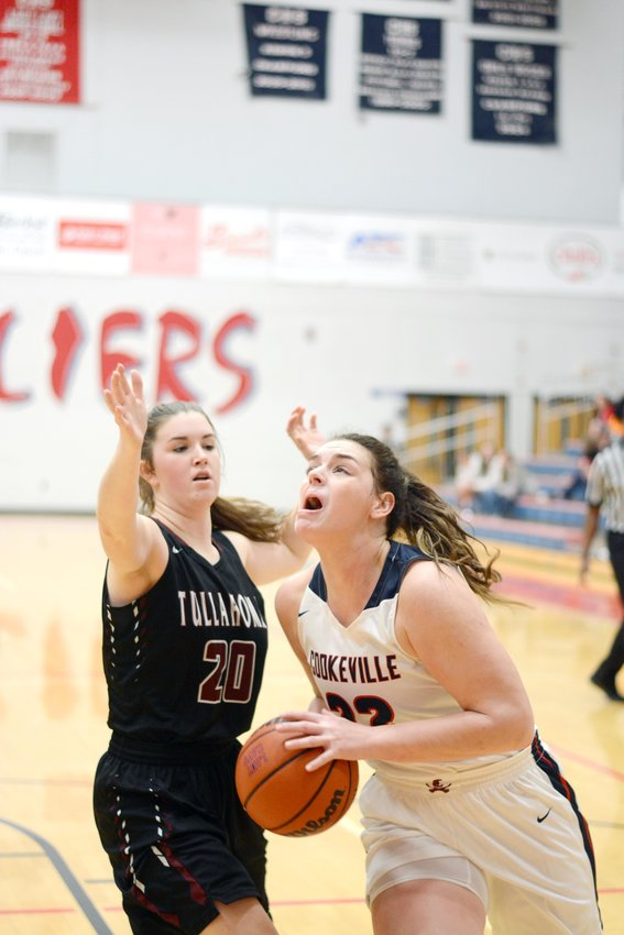 Cookeville's Chloe Grace Savage, right, looks to shoot over a Tullahoma defender during the Lady Cavs' 60-49 win over the Lady Wildcats Thursday at CHS.