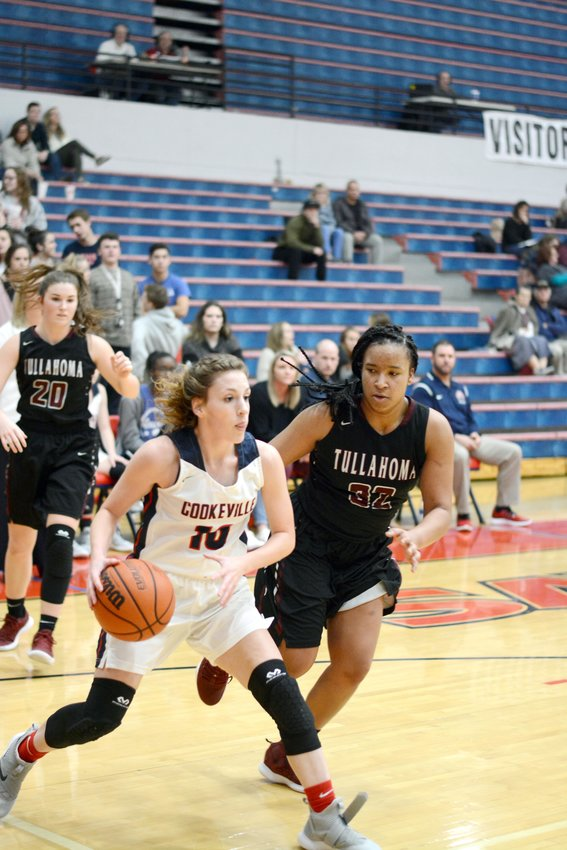 Cookeville's Julianne Dunaway, left, drives past a Tullahoma defender during the Lady Cavs' 60-49 win over the Lady Wildcats Thursday at CHS.
