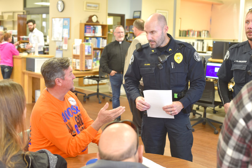 Cookeville Police Department Sgt. Brian Long spoke with a protester that was asked to stop soliciting materials within the library.