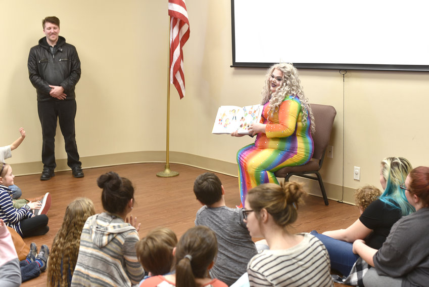 Kitty Lovelle, a woman that performs in drag, reads to children at the Drag Queen Story Hour at the Putnam County Library.