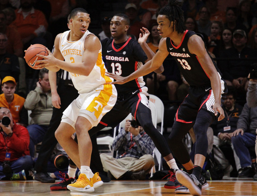 Tennessee forward Grant Williams (2) looks for the shot while Georgia forward E'Torrion Wildrige (13) and Nicolas Claxton (33) defend in the first half of a game Saturday in Knoxville.