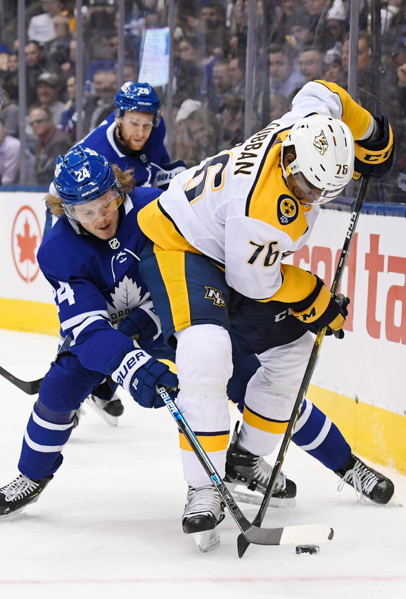 Toronto Maple Leafs right wing Kasperi Kapanen (24) and Nashville Predators defenceman P.K. Subban (76) battle for the puck during second-period NHL hockey game action in Toronto, Monday, Jan. 7, 2019. (Nathan Denette/The Canadian Press via AP)