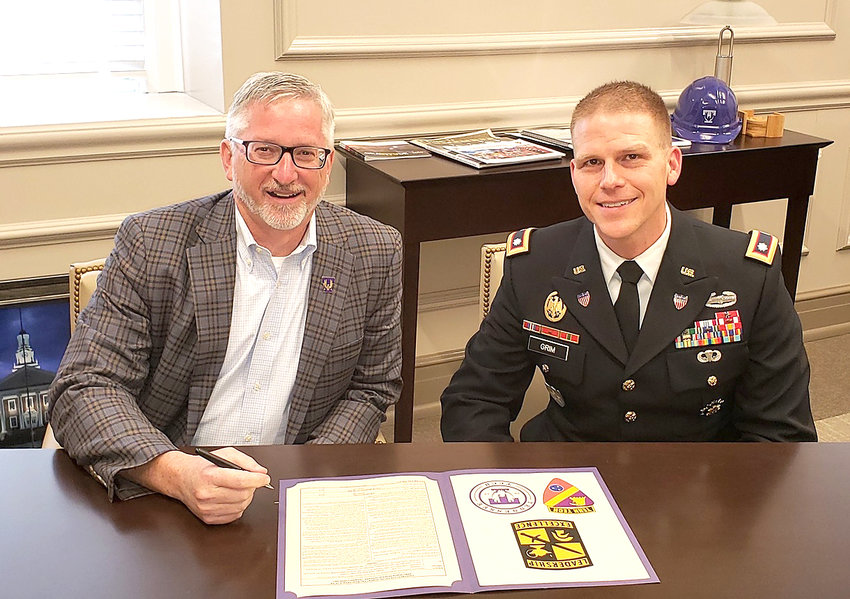 Signing the 10 year ROTC contract, from left, are Tennessee Tech President Phil Oldham and Lt. Col. Adam Grim.
