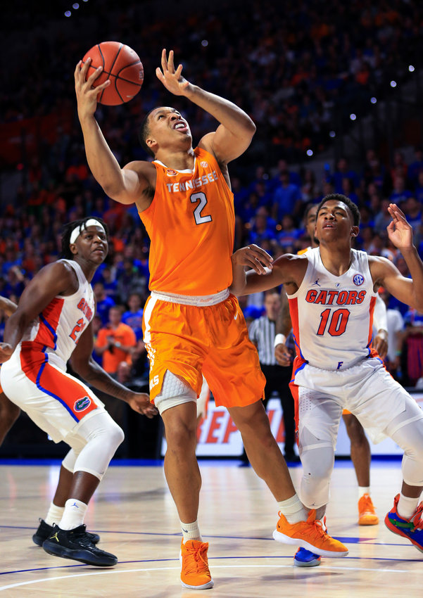 Tennessee forward Grant Williams (2) shoots next to Florida guard Noah Locke (10) during the first half of a game Saturday, in Gainesville, Fla.