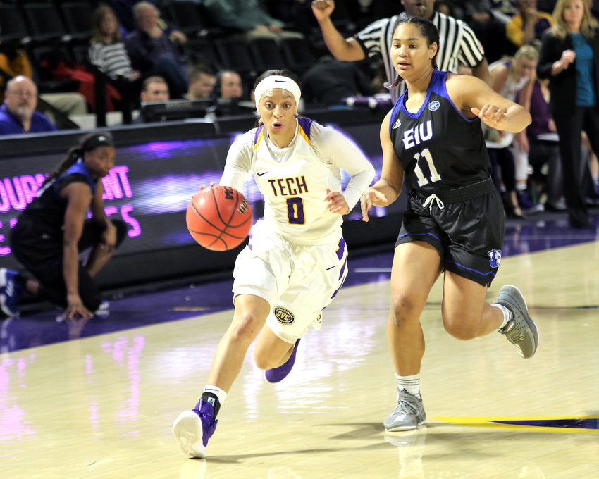 Tennessee Tech's Akia Harris, left, runs around an EIU defender during the Golden Eagles' 99-88 win over the Lady Panthers Saturday in the Eblen Center.