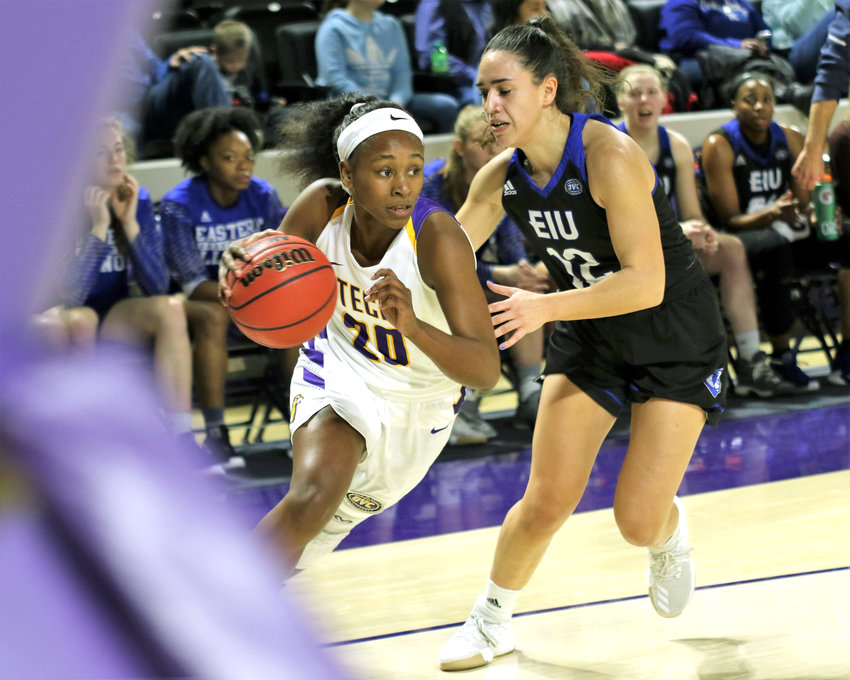 Tennessee Tech's Kesha Brady, left, runs around an EIU defender during the Golden Eagles' 99-88 win over the Lady Panthers Saturday in the Eblen Center.
