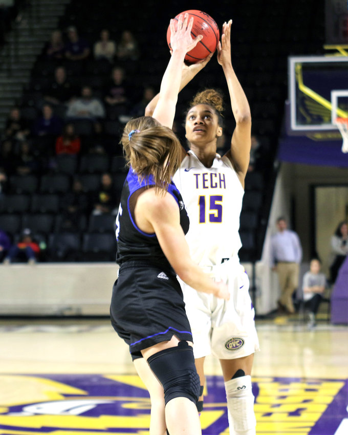 Tennessee Tech's Anacia Wilkinson, right, shoots over an EIU defender during the Golden Eagles' 99-88 win over the Lady Panthers Saturday in the Eblen Center.