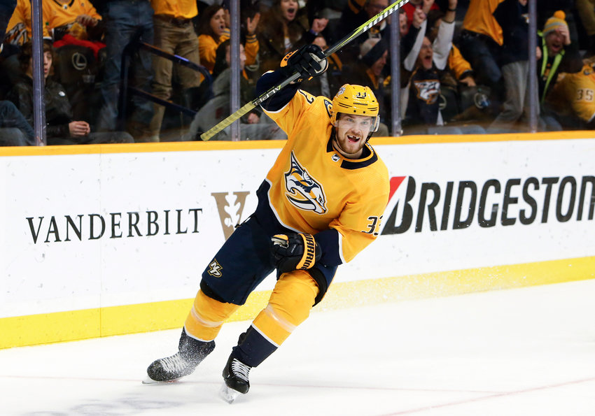 Nashville Predators left wing Viktor Arvidsson, of Sweden, celebrates after scoring his third goal of the night for a hat trick against the Washington Capitals, during the second period of an NHL hockey game Tuesday, Jan. 15, 2019, in Nashville, Tenn. (AP Photo/Mark Humphrey)