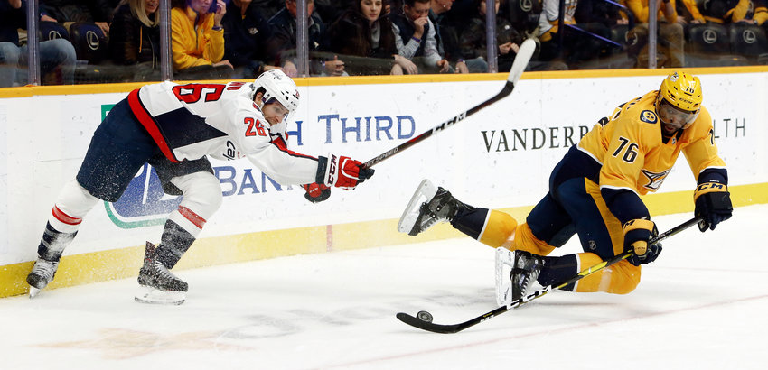Washington Capitals center Nic Dowd (26) and Nashville Predators defenseman P.K. Subban (76) chase the puck during the first period of an NHL hockey game Tuesday, Jan. 15, 2019, in Nashville, Tenn. (AP Photo/Mark Humphrey)