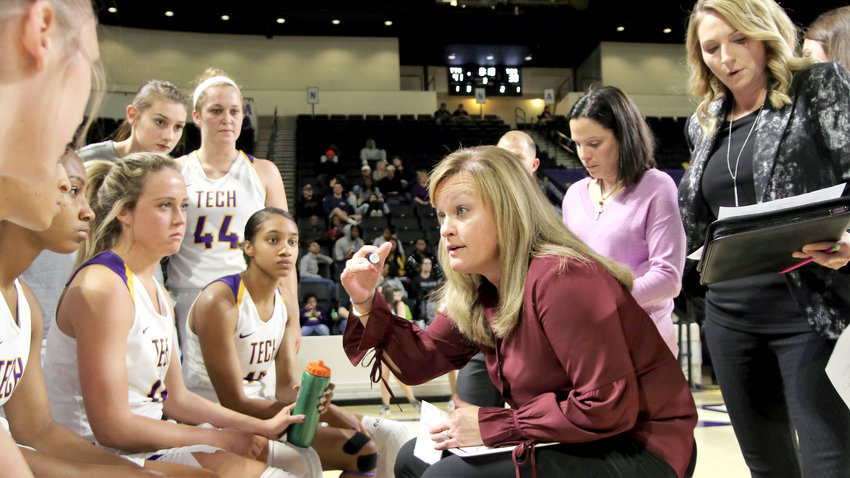 Tennessee Tech head coach Kim Rosamond, right, gives instruction to her team during the Golden Eagles' 76-65 win over TSU Wednesday night in the Eblen Center.