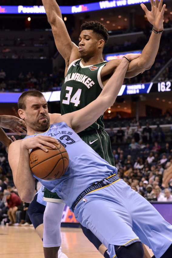 Milwaukee Bucks forward Giannis Antetokounmpo (34) fouls Memphis Grizzlies center Marc Gasol (33) in the first half of an NBA basketball game Wednesday, Jan. 16, 2019, in Memphis, Tenn. (AP Photo/Brandon Dill)