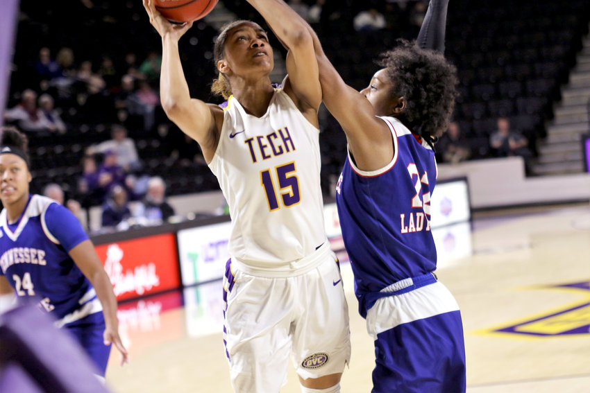 Tennessee Tech's Anacia Wilkinson, left, shoots over a TSU defender during the Golden Eagles' 76-65 win over the Lady Tigers Wednesday in the Eblen Center.