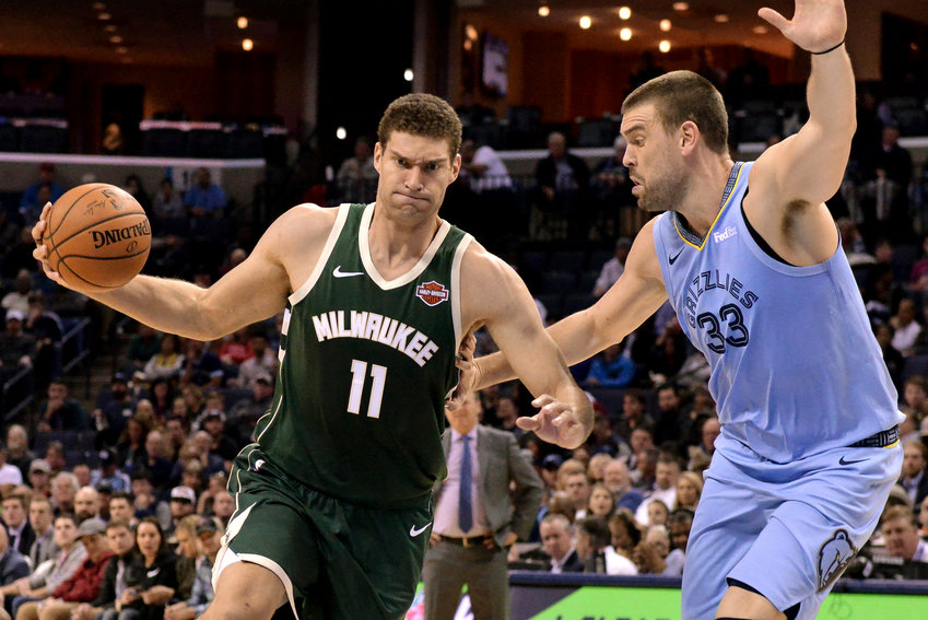 Milwaukee Bucks center Brook Lopez (11) drives against Memphis Grizzlies center Marc Gasol (33) in the first half of an NBA basketball game Wednesday, Jan. 16, 2019, in Memphis, Tenn. (AP Photo/Brandon Dill)