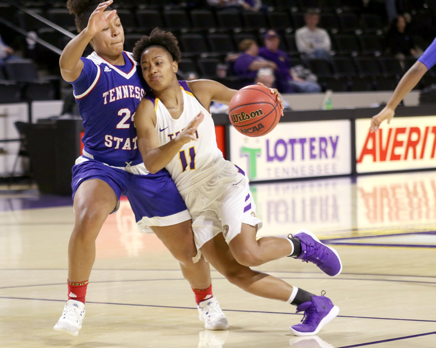 Tennessee Tech's Kentoria Alexander, right, engages a TSU defender during the Golden Eagles' 76-65 win over the Lady Tigers Wednesday in the Eblen Center.