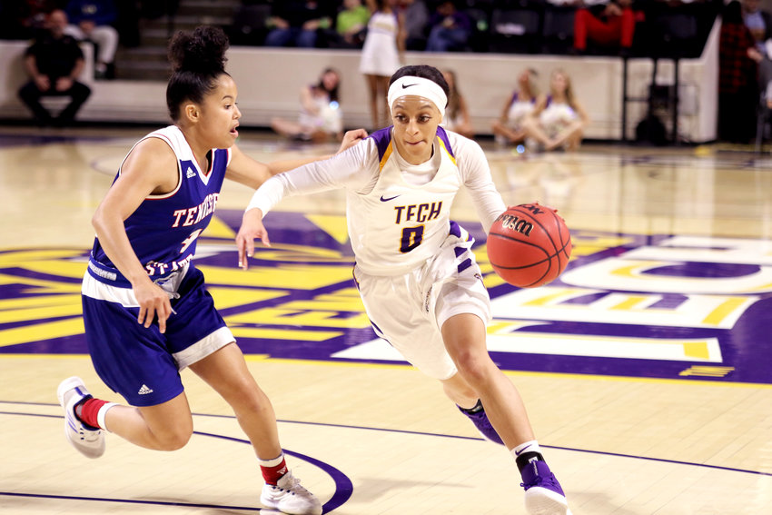 Tennessee Tech's Akia Harris, right, runs around a TSU defender during the Golden Eagles' 76-65 win over the Lady Tigers Wednesday in the Eblen Center.