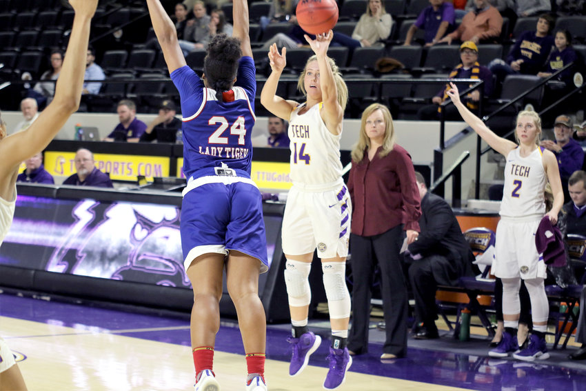 Tennessee Tech's Abby Buckner, right, shoots over a TSU defender during the Golden Eagles' 76-65 win over the Lady Tigers Wednesday in the Eblen Center.