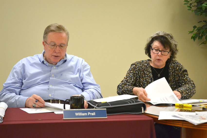 Administrator of Elections Debbie Steidl, right, looks over information about Putnam County precincts with Election Commissioner William Prall.