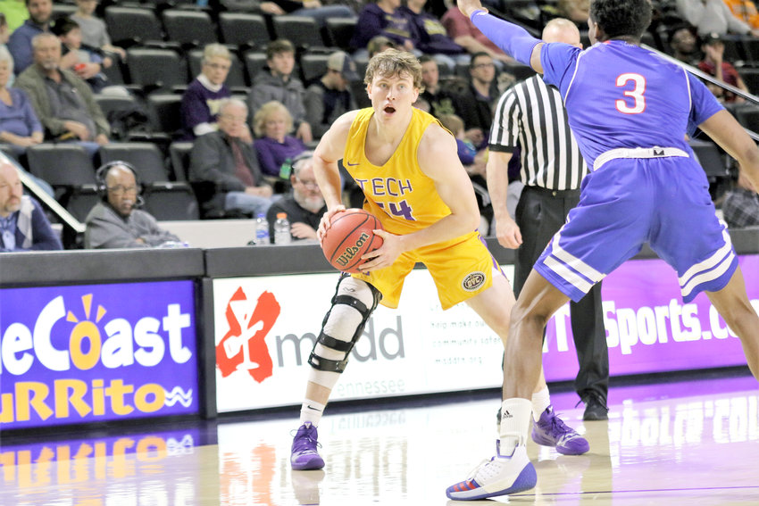Tennesssee Tech's Cade Crosland looks for a teammate during the Golden Eagles' battle Thursday night with Tennessee State University.  Tech committed 20 turnovers and lost the battle on the boards as the Golden Eagles fell to the Ohio Valley Conference foe 79-62.