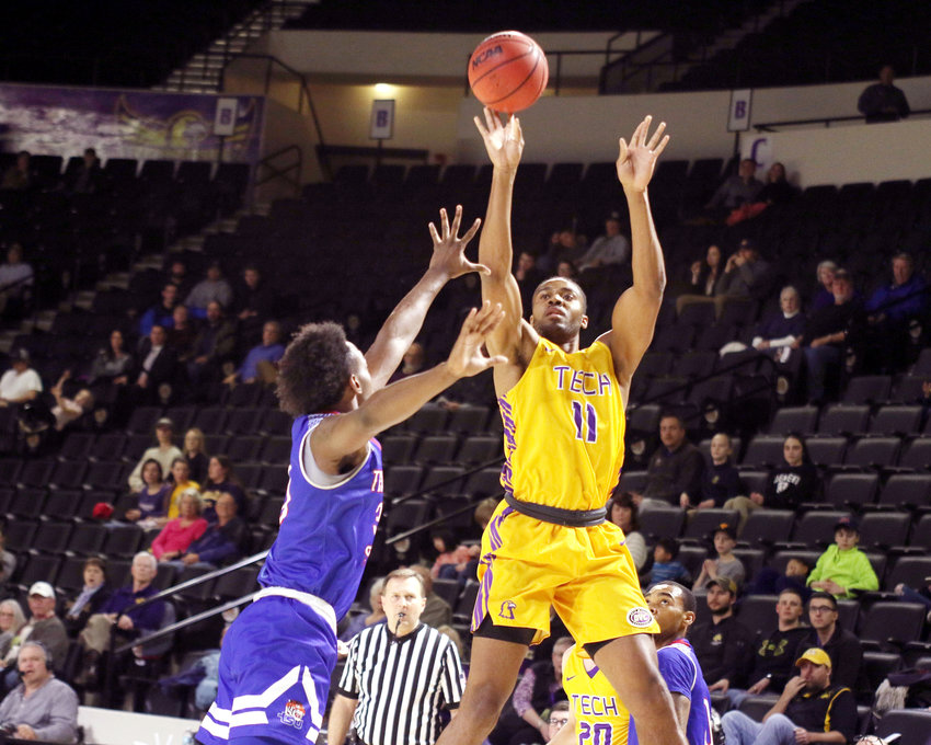 Tech's Micaiah Henry goes high for a shot during the Golden Eagles' game with Tennessee State Thursday.
