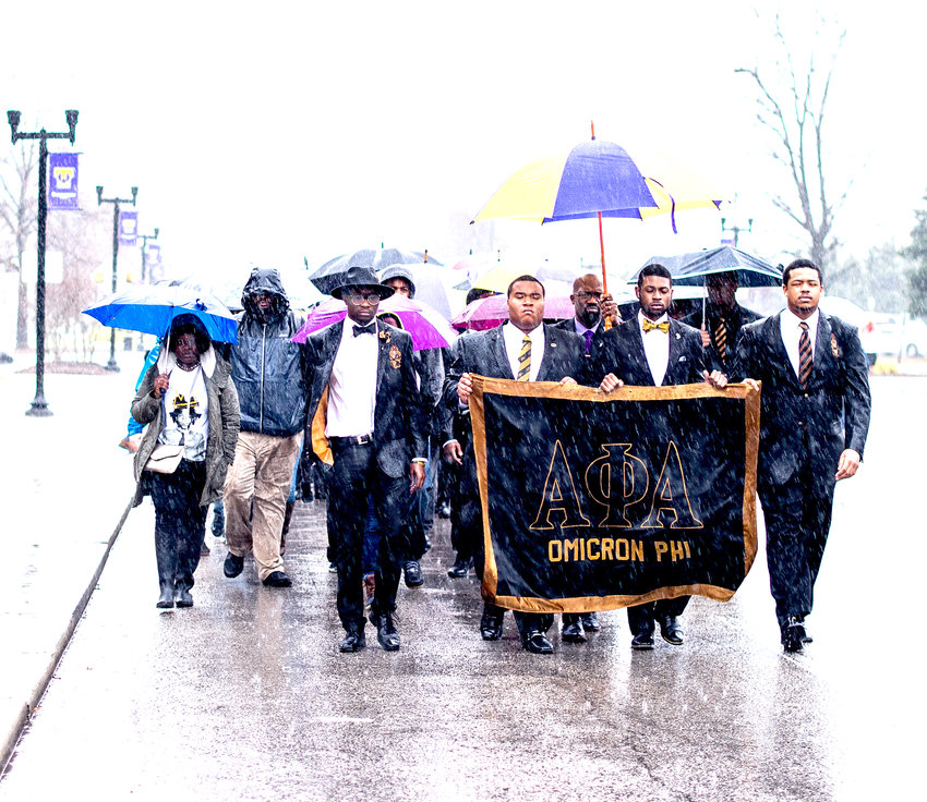 Alpha Phi Alpha fraternity members participate in a Martin Luther King Jr. remembrance in 2017.