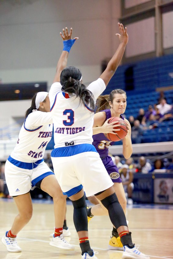 Tennessee Tech's Mackenzie Coleman drives around two Tennessee State University defenders during a recent game.