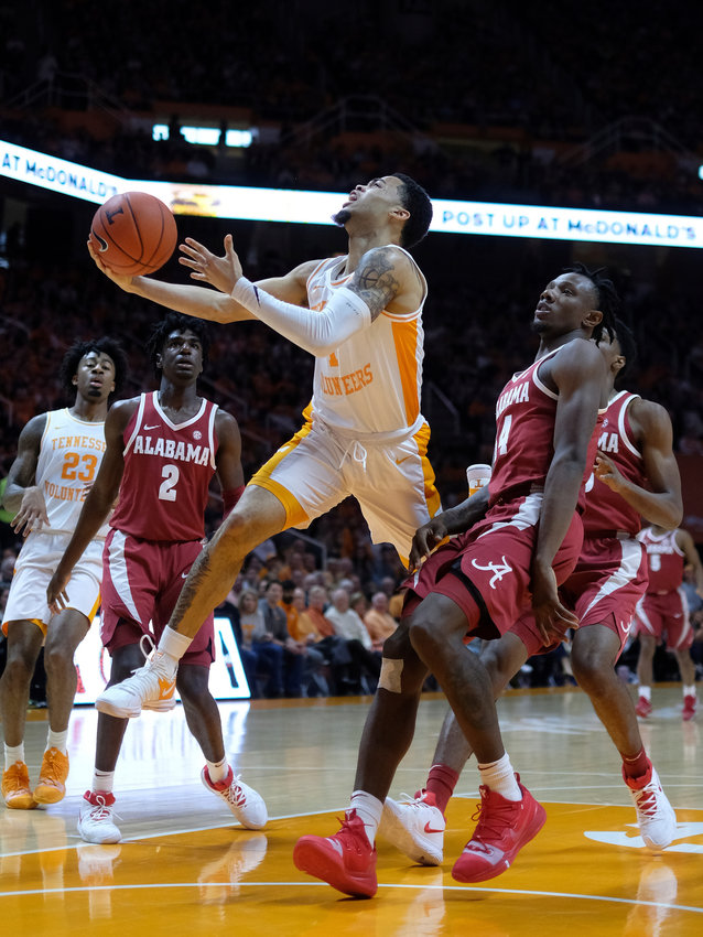 Tennessee guard Lamonte Turner (1) attempts a shot against Alabama forward Tevin Mack (34) in the first half of a game, Saturday, in Knoxville.