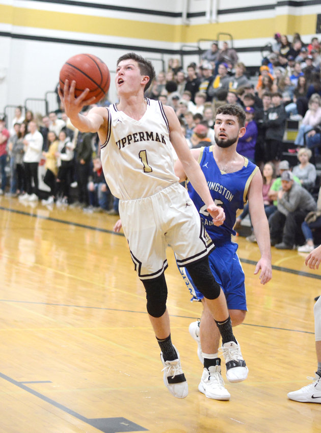 Upperman's Collin Gore, left, shoots past a Livingston Academy defender during the Bees' 69-56 win over the Wildcats Friday in Baxter.
