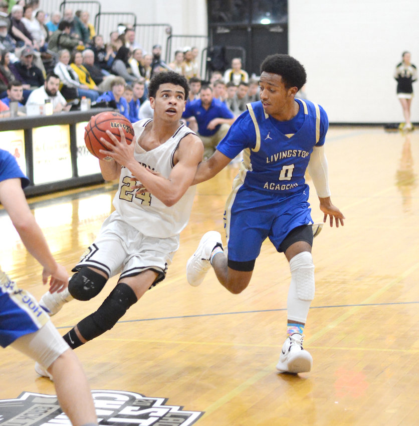 Upperman's Isaiah Allen, left, drives past a Livingston Academy defender during the Bees' 69-56 win over the Wildcats Friday in Baxter.