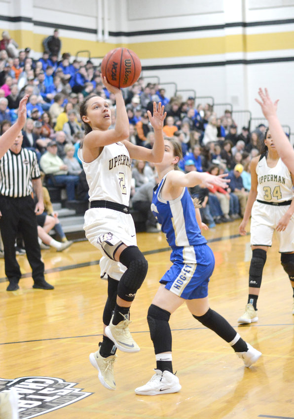 Upperman's Aiyana Levy, left, floats a shot past a Livingston Academy defender during the Lady Bees' 51-25 win over the Lady Wildcats Friday in Baxter.