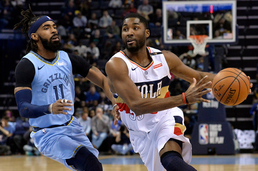 New Orleans Pelicans guard E'Twaun Moore (55) drives against Memphis Grizzlies guard Mike Conley (11) in the first half of an NBA basketball game Monday, Jan. 21, 2019, in Memphis, Tenn. (AP Photo/Brandon Dill)