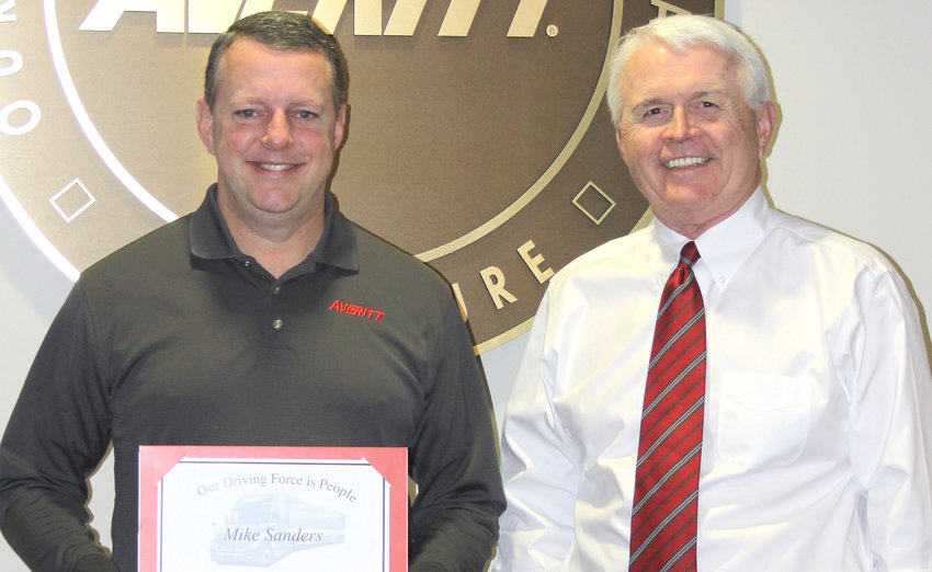 Averitt Express director of pricing Mike Sanders, left, is presented his 25-year service award by Averitt president and chief operating officer Wayne Spain.