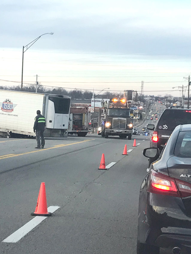 Traffic stops on South Jefferson Avenue Friday afternoon following a crash involving a tractor trailer.