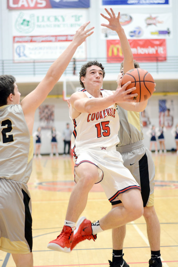 Cookeville's Stockton Owen, center, shoots between two Stone Memorial defenders during the Cavs' 55-36 loss Friday night at CHS.