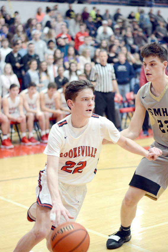 Cookeville's Zach Hall, left, drives past a Stone Memorial defender during the Cavs' 55-36 loss Friday night at CHS.
