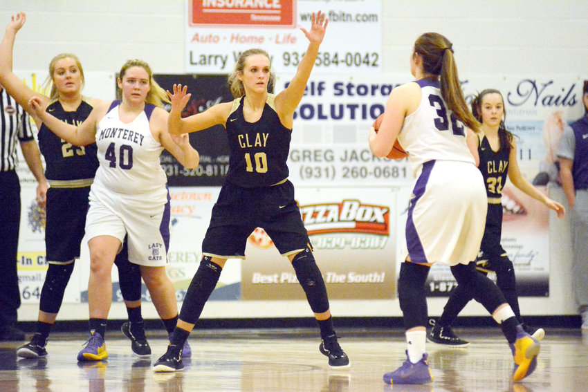 Clay County senior Taylor Strong, guarding Monterey's Grace Clouse during a game earlier this season, hopes to cap a fine prep career by helping the Lady Bulldogs reach the state tournament.