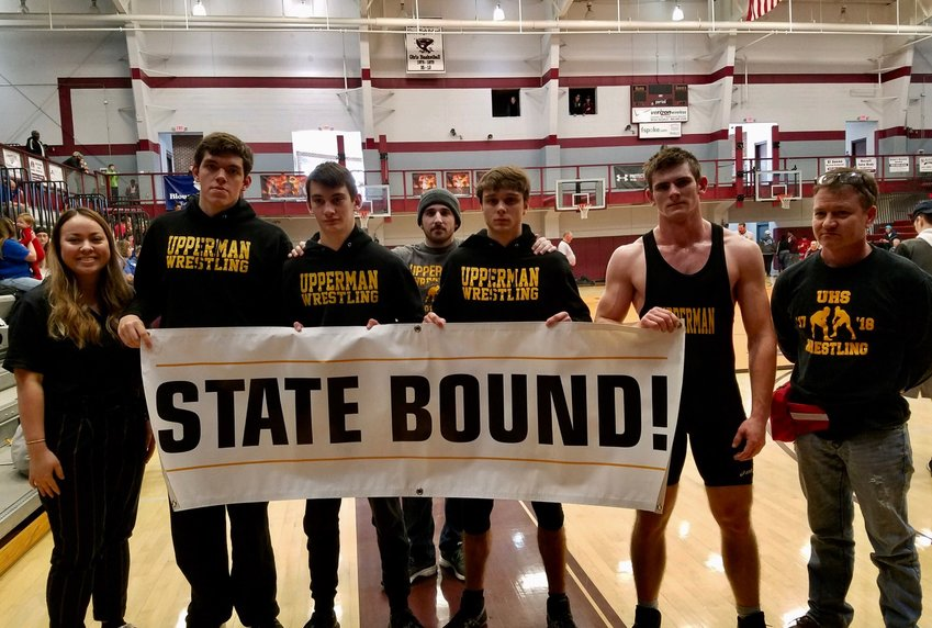 The Upperman High School Bees qualified four wrestlers for the upcoming state championships following their good performances Saturday at the regional championships. Pictured above are, from left: assistant coach Jessica Jackson, Tyler Whitcomb (4th), Dylon Dobbs (4th), assistant coach Jeff Baker, Patrick Lair (4th), Caleb West (champion), and head coach Jason Halcomb.