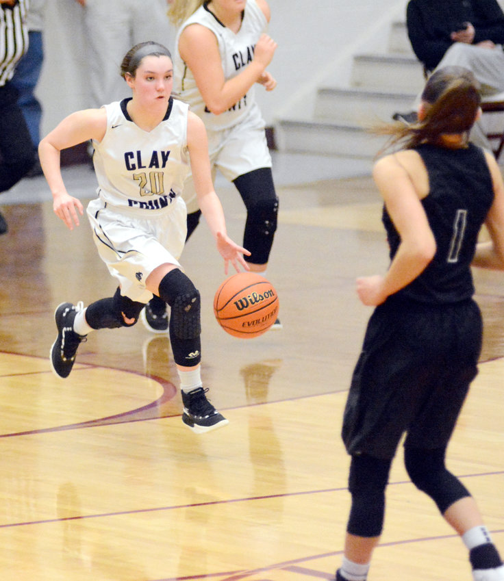 Clay County's Rachel Copass bring the ball up the floor for the Lady Bulldogs' in their victory over ranked Pickett County Thursday.