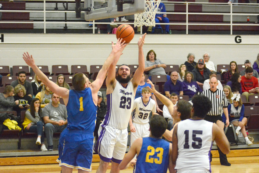Monterey's Grayson Randolph (23) shoots over a Clarkrange defender during the Wildcats' 47-44 win over the Buffaloes Friday night in Sparta.