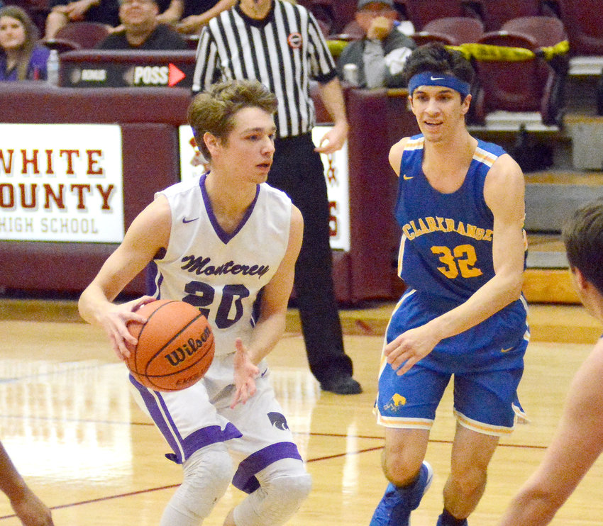Peyton West, left, splits the Clarkrange defense during action Tuesday night in Sparta.